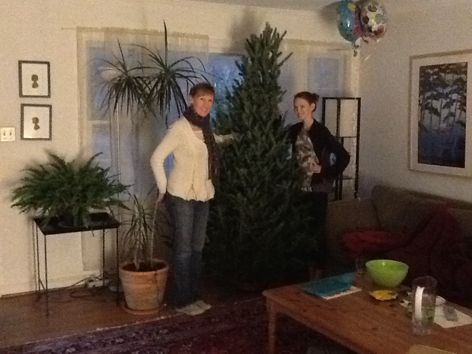 Stacy and Tressa are pleased with their tree, the second to be sold at Johnny's Gone Fishing LLC