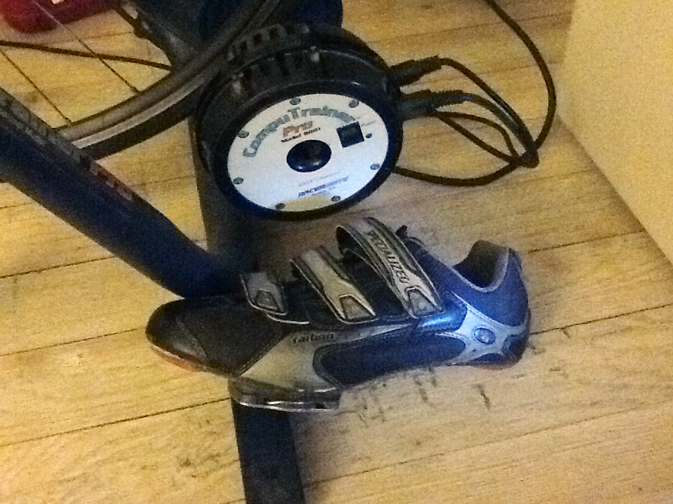 CompuTrainer drive module next to my favorite old bike shoe.