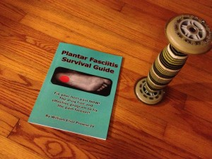 Photo of The Plantar Fasciitis Survival Guide by William Errol Prowse IV and a Trigger Point Performance roller preferred by FitOldDog. Photo by FitOldDog.